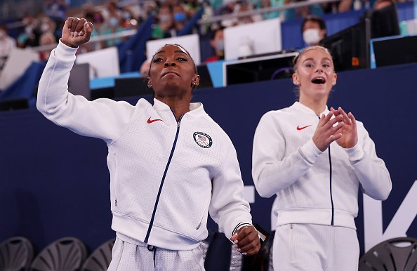 Simone Biles and Grace McCallum of Team United States cheer during the Women's Team Final on day four of the Tokyo 2020 Olympic Games | Source: Getty Images