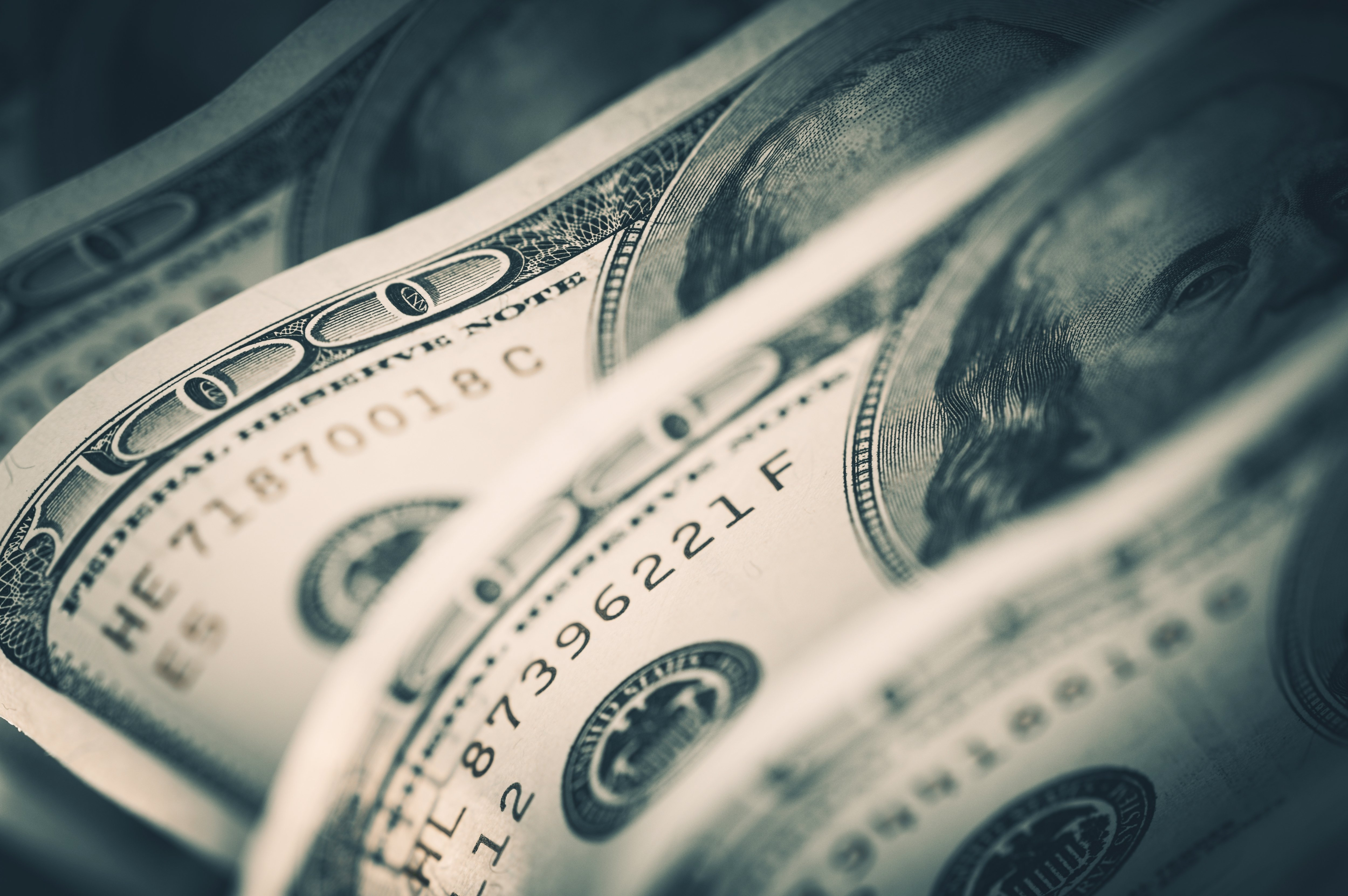 A close up look at a couple of $100 dollar bills. | Photo: Shutterstock