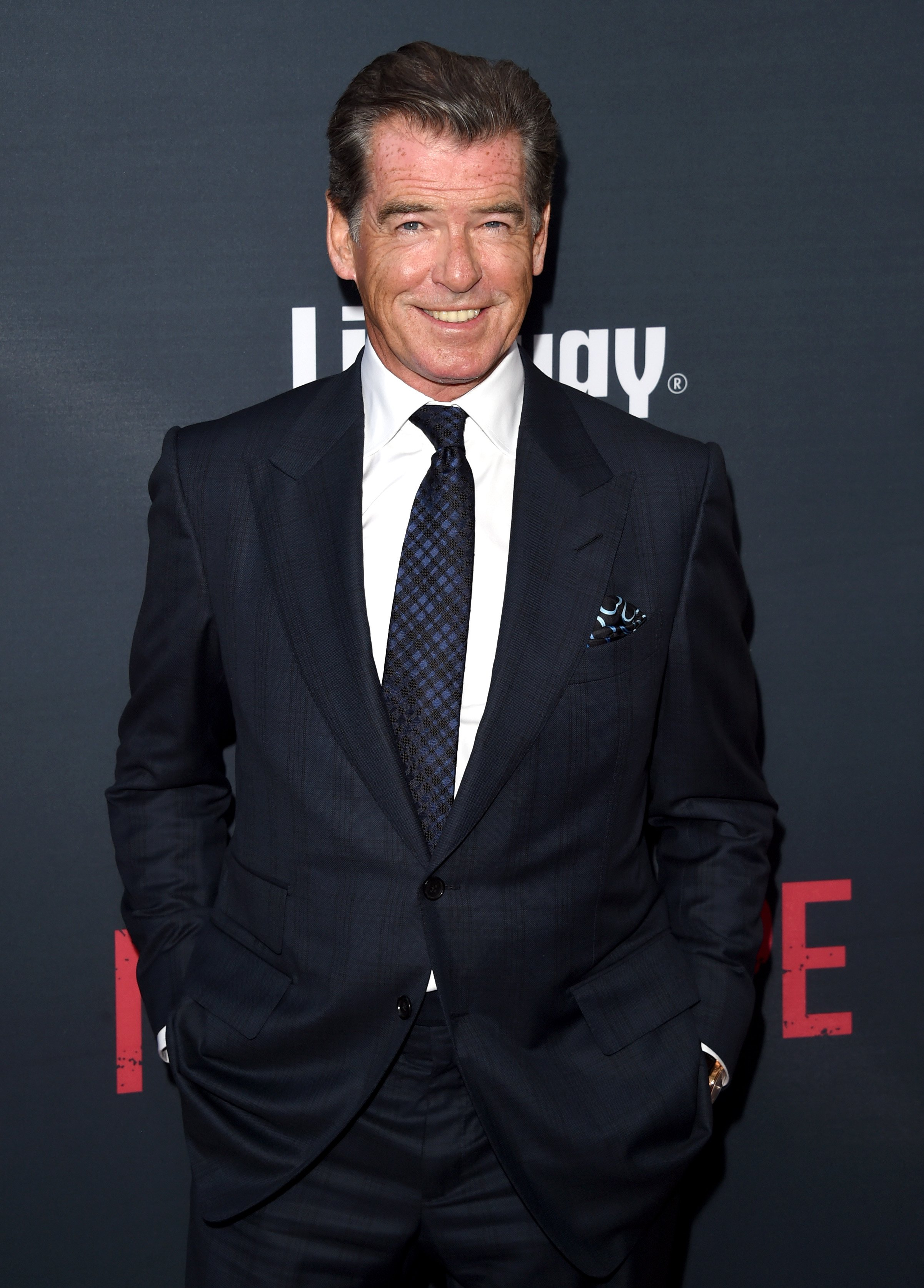 "Pierce Brosnan arrives at The Premiere Of The Weinstein Company's ""No Escape"" at Regal Cinemas L.A. Live on August 17, 2015. 