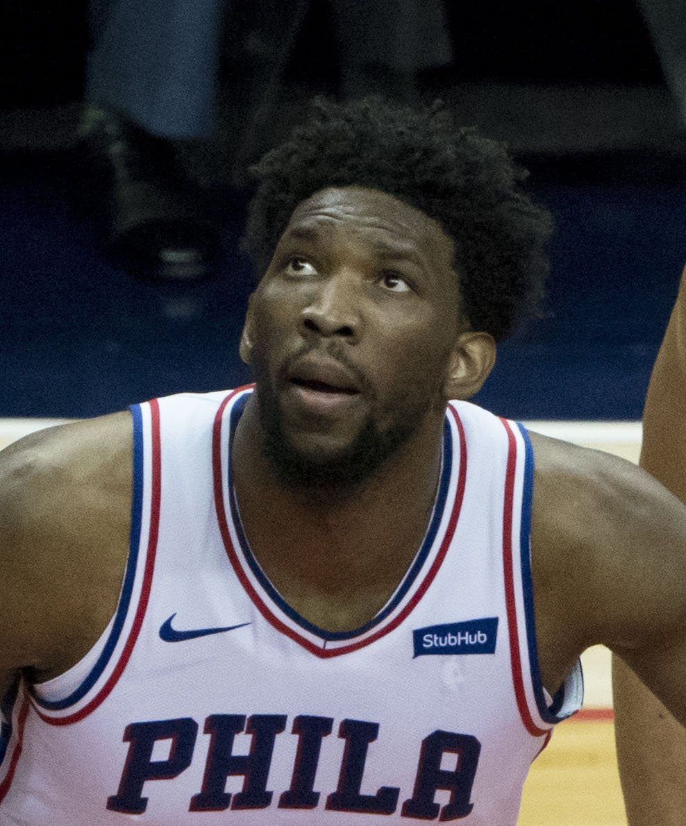 Joel Embiid of the 76ers at a game against the Wizards on February 8, 2018. | Photo by Keith Allison, Joel Embiid 2018c, CC BY-SA 2.0, Wikimedia Commons