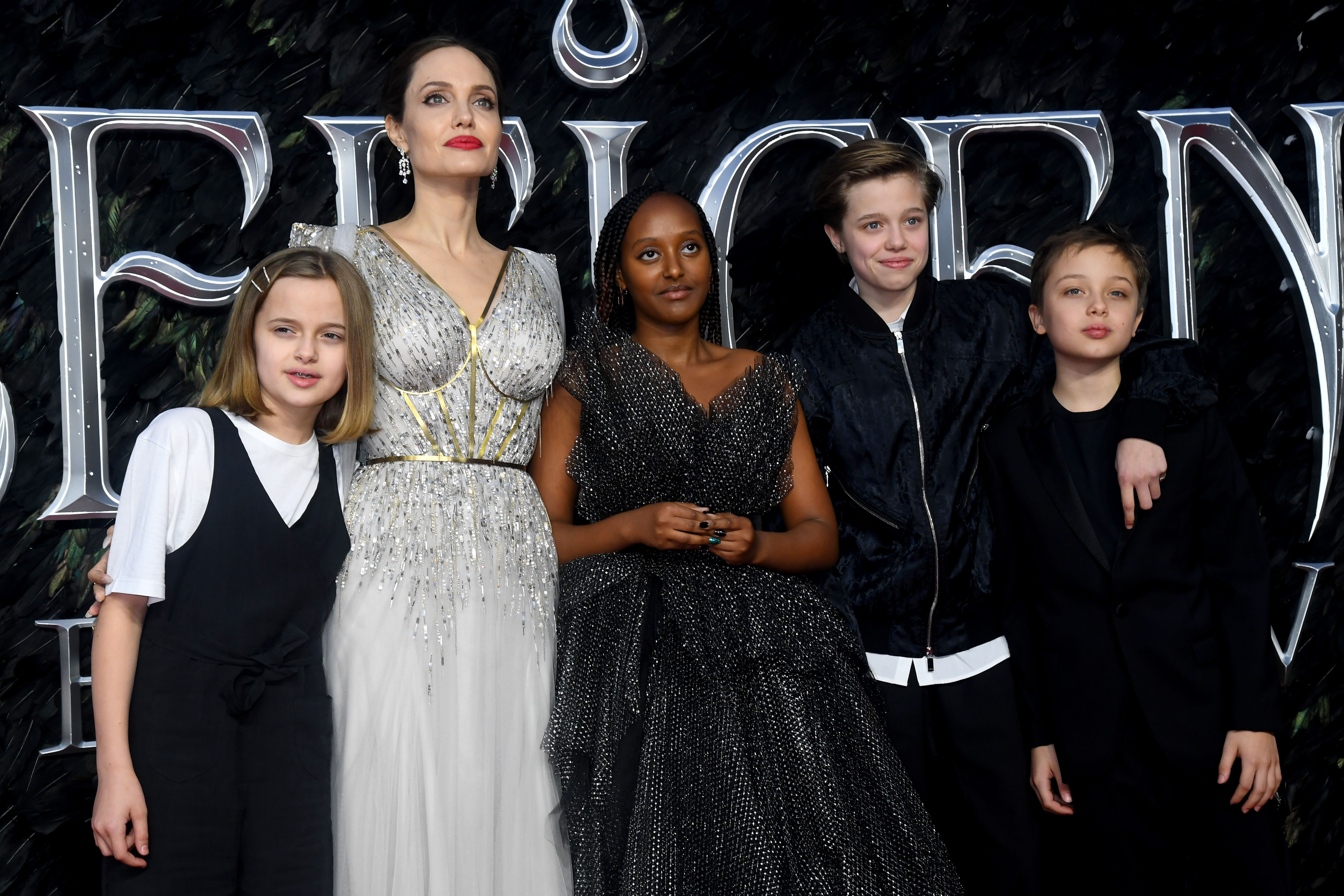 """Angelina Jolie with her kids at the European premiere of """"Maleficent: Mistress of Evil"""" at Odeon IMAX Waterloo on October 09, 2019 