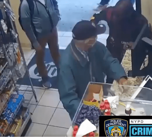 Serlin in the deli, just before the robbery   Source: Facebook/NYPDCrimeWatch