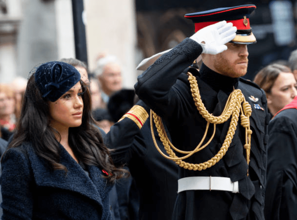 Meghan Markle stands with Prince Harry as he salutes the 91st Field of Remembrance at Westminster Abbey, on November 7, 2019 in London, England | Source: Mark Cuthbert/UK Press via Getty Images