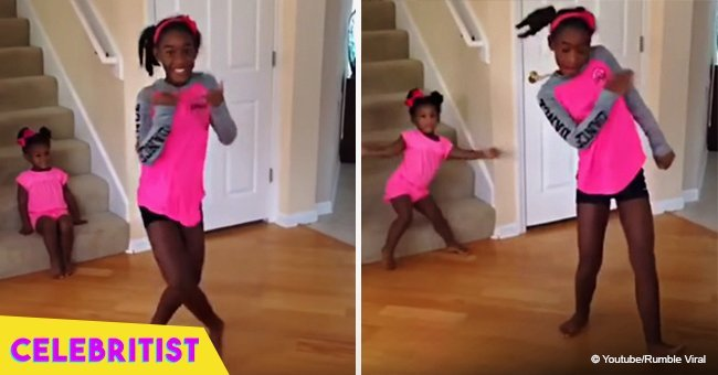 Toddler steals the show from big sister by dancing in the background in viral video