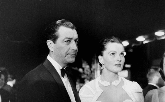 """Actor Robert Taylor and wife Ursula Thiess attend the premiere of """"King and I"""" in Los Angeles,CA. June 1956. 