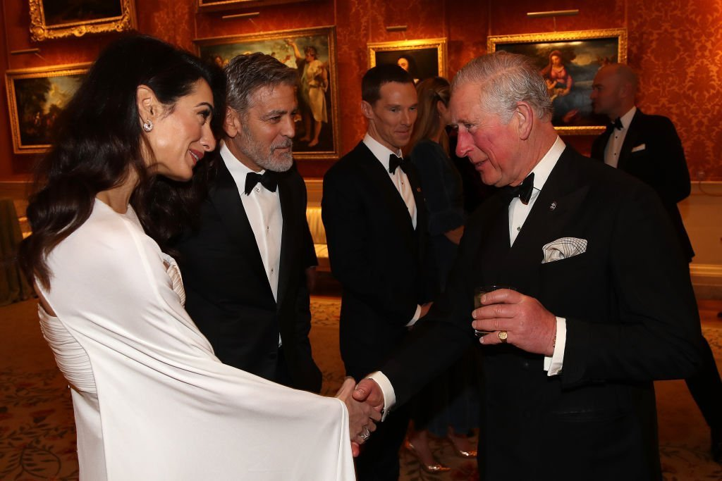 Amal Clooney and George Clooney attend a dinner to celebrate The Prince's Trust at Buckingham Palace on March 12, 2019 | Photo: Getty Images