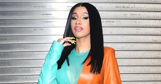Watch Cardi B Show off Her Dancing Skills in a Bright Red Outfit While at a House Party