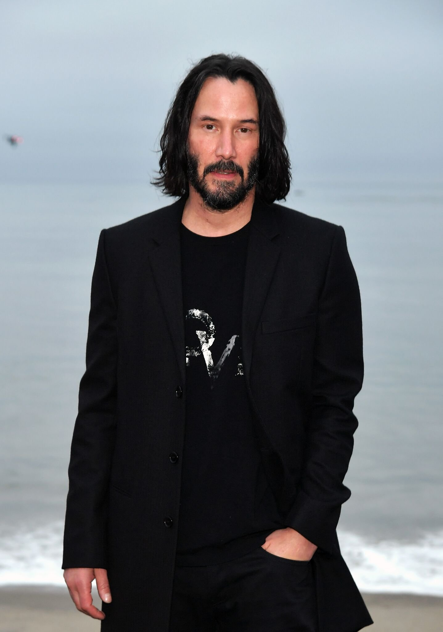 Keanu Reeves at the Saint Laurent Mens Spring Summer 20 Show on June 06, 2019 in Paradise Cove Malibu, California | Photo: Getty Images