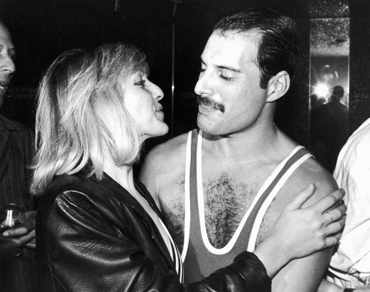 Freddie Mercury with his friend Mary Austin during his 38th birthday party at the Xenon nightclub in 1984. | Source: Getty Images