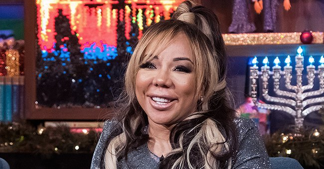 See Tiny Harris's Granddaughter with Her Growing Hair & Baby Face Sitting in Carrier in New Pics with Mom