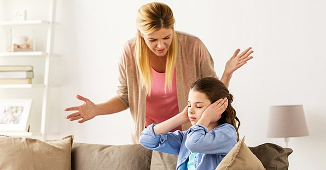 Two woman are arguing. One has her hands over her ears, while the other shouts. | Photo: Shutterstock