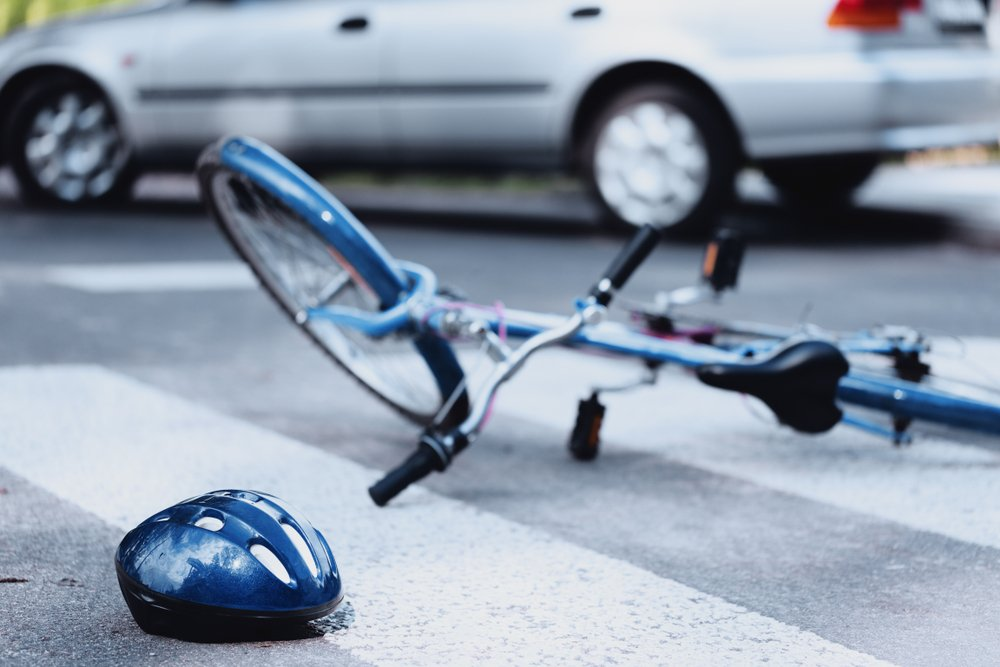 A photo of an accident involving a car and a cyclist | Photo: Shutterstock