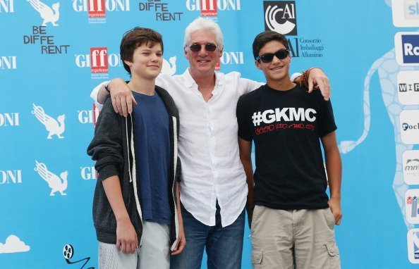 Richard Gere and his son Homer (1st left) attend the Giffoni Film Festival photocall on July 22, 2014, in Giffoni Valle Piana, Italy. | Source: Getty Images.