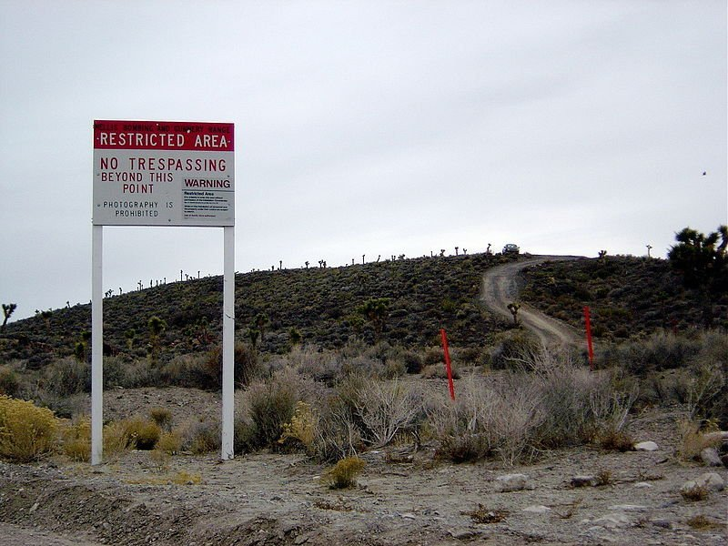 "Area 51 border and warning sign stating that ""photography is prohibited"" and that ""use of deadly force"" is authorized 
