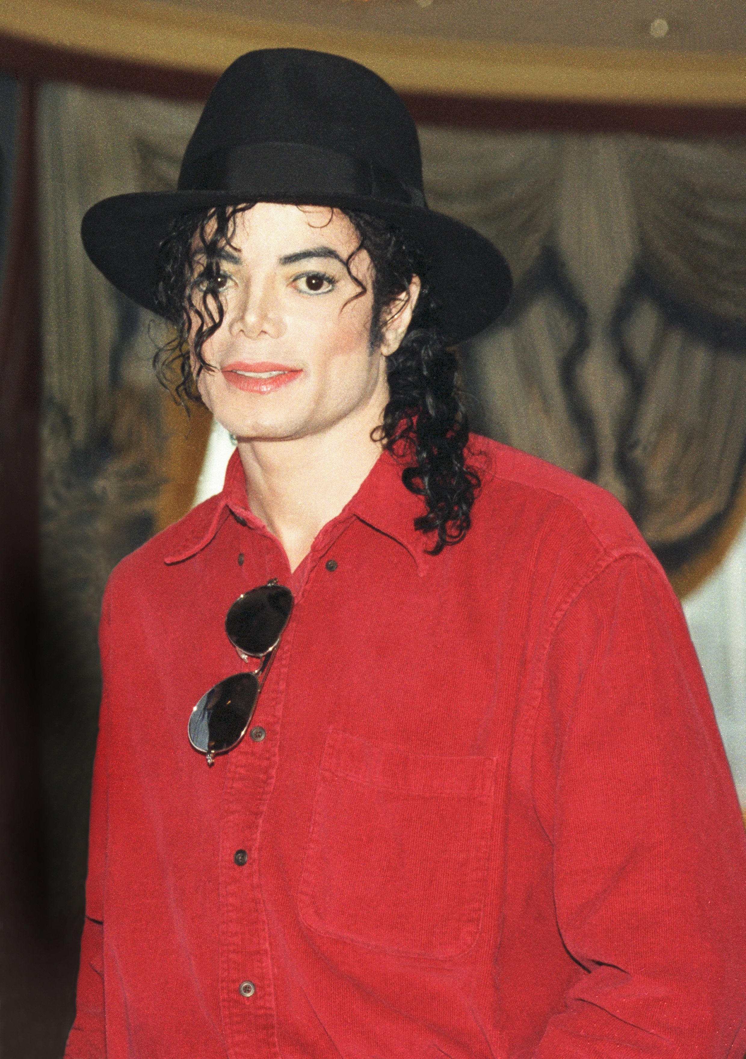 Michael Jackson poses at a press conference before a date on his HIStory world tour in 1996. | Source: Getty Images