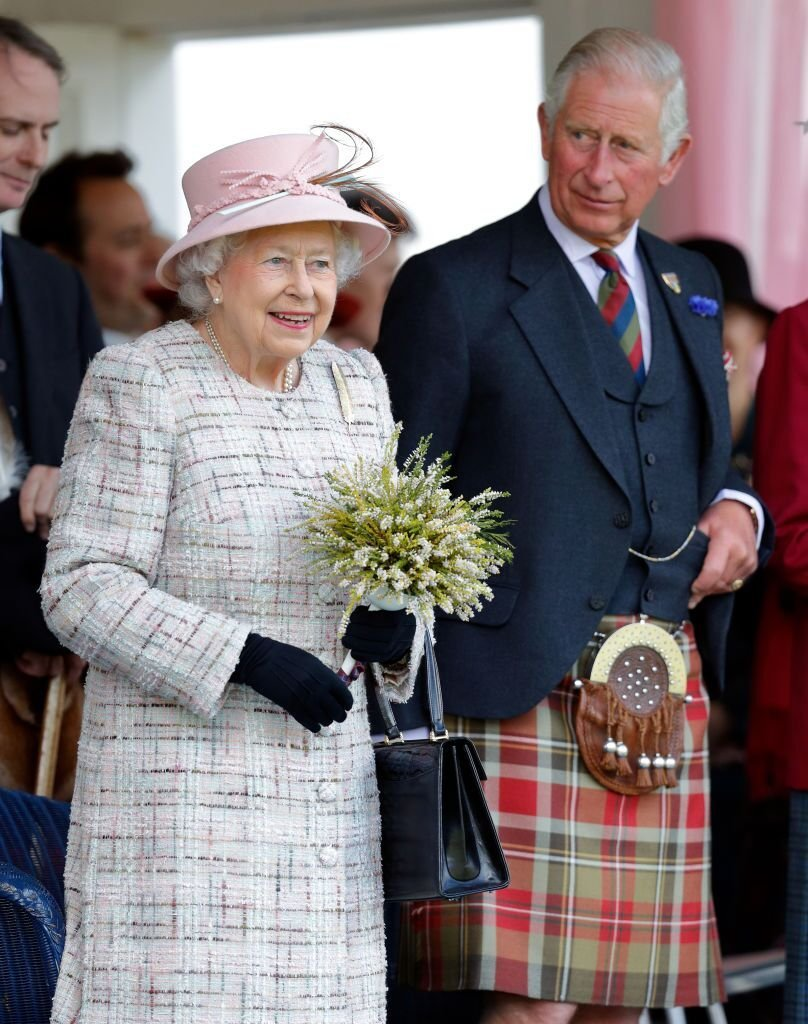 Queen Elizabeth II and Prince Charles, Prince of Wales attend the 2017 Braemar Gathering at The Princess Royal and Duke of Fife Memorial Park on September 2, 2017 in Braemar, Scotland. | Photo: Getty Images