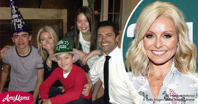 Kelly Ripa exchanged ugly sweaters for funny props when posing for family New Year photos