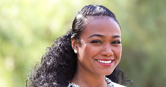 Tatyana Ali of 'The Fresh Prince of Bel-Air' Poses with Family near a Fireplace on 42nd B-Day