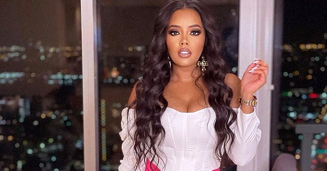 Angela Simmons Puts Her Leg on Display Posing in a Pink Skirt with an off-Shoulder Blouse