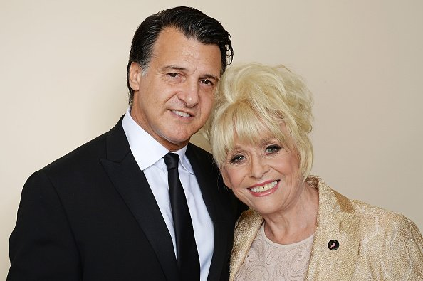 Barbara Windsor and Scott Mitchell at the Amy Winehouse Foundation Gala in London. | Photo: Getty Images.