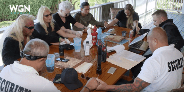 Duane and Beth Chapman praying together on the promo trailer of Dog's Most Wanted | Photo: YouTube/WGN America