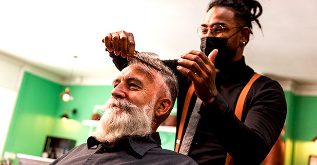 A photo of a barber giving a haircut. | Photo: Shutterstock