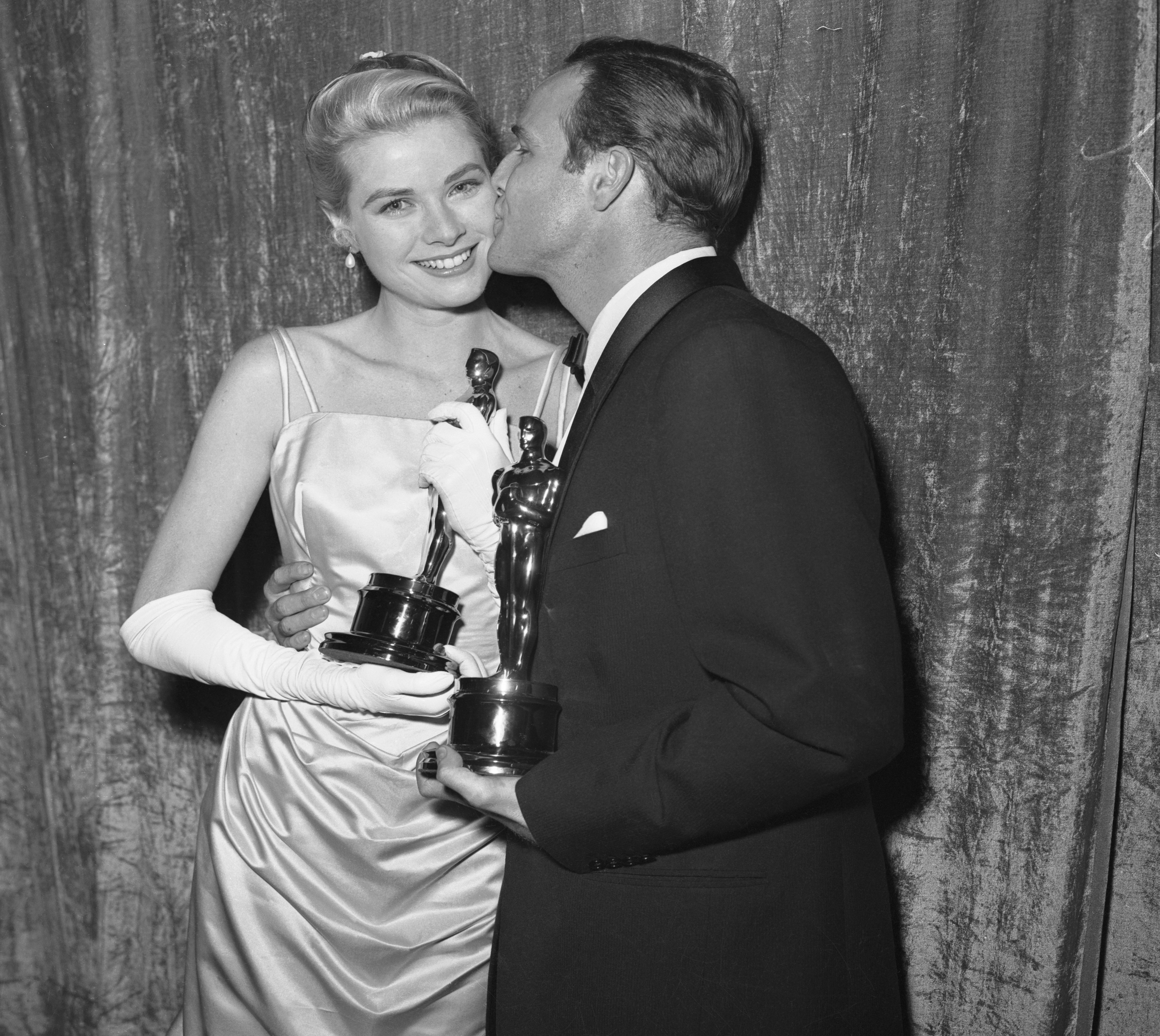 """Actress Grace Kelly holding her Oscar after she was honored as the """"Best Actress"""" of 1954 at the 27th Academy Awards.   Source: Getty Images"""