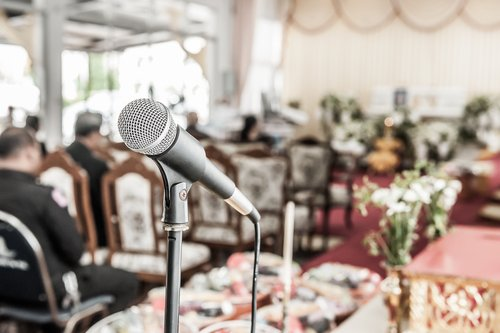 A close up of a microphone for speeches during a funeral. | Source: Shutterstock.