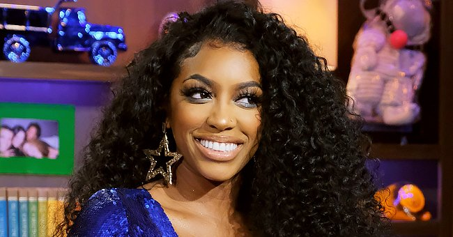 Porsha Williams of RHOA Stuns with Her Legs & Cleavage on Display in a One-Piece Gucci Swimsuit