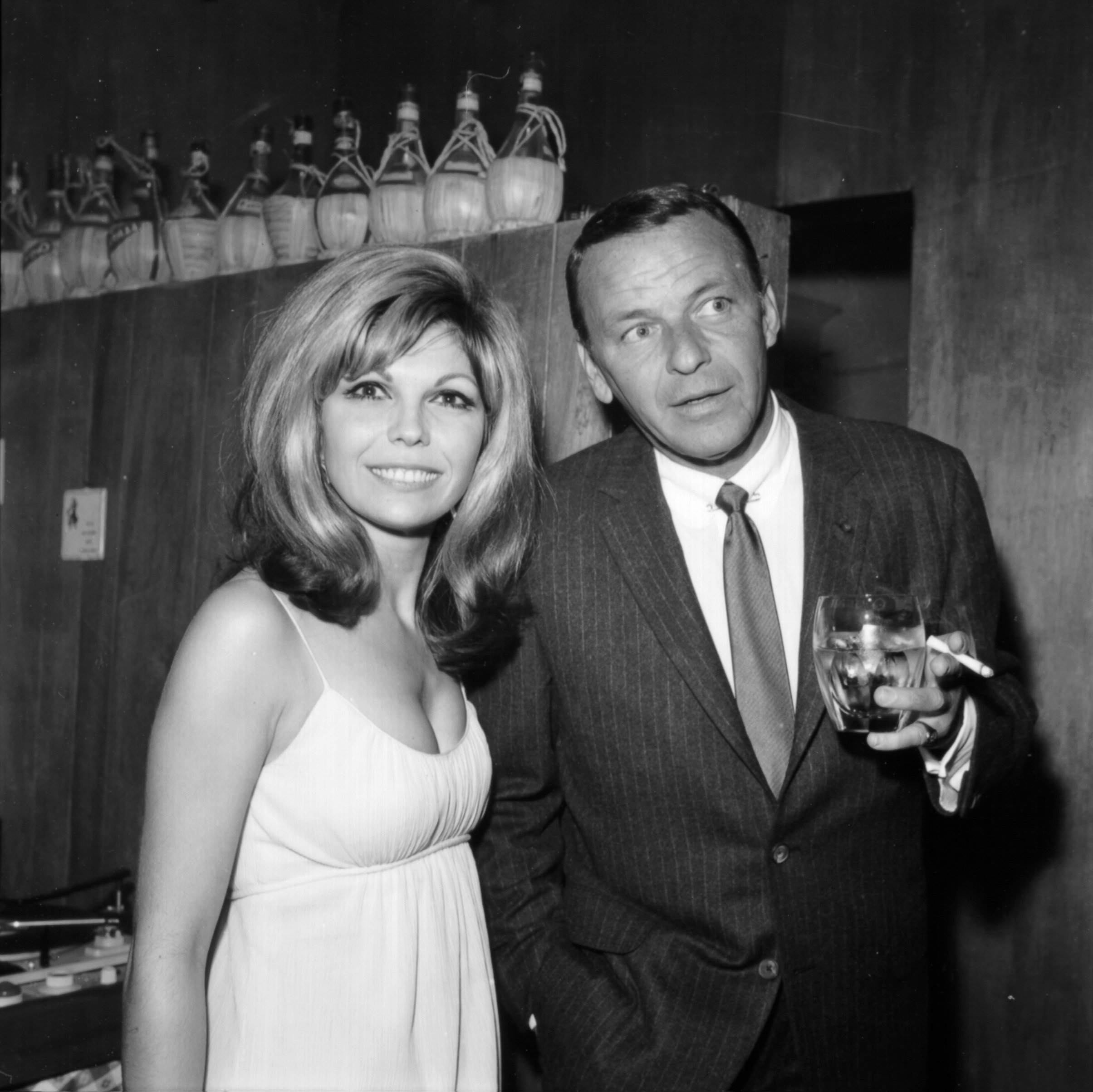 Pop singer Frank Sinatra enjoys a cocktail at an event with his daughter singer Nancy Sinatra in circa 1967 | Photo: Getty Images