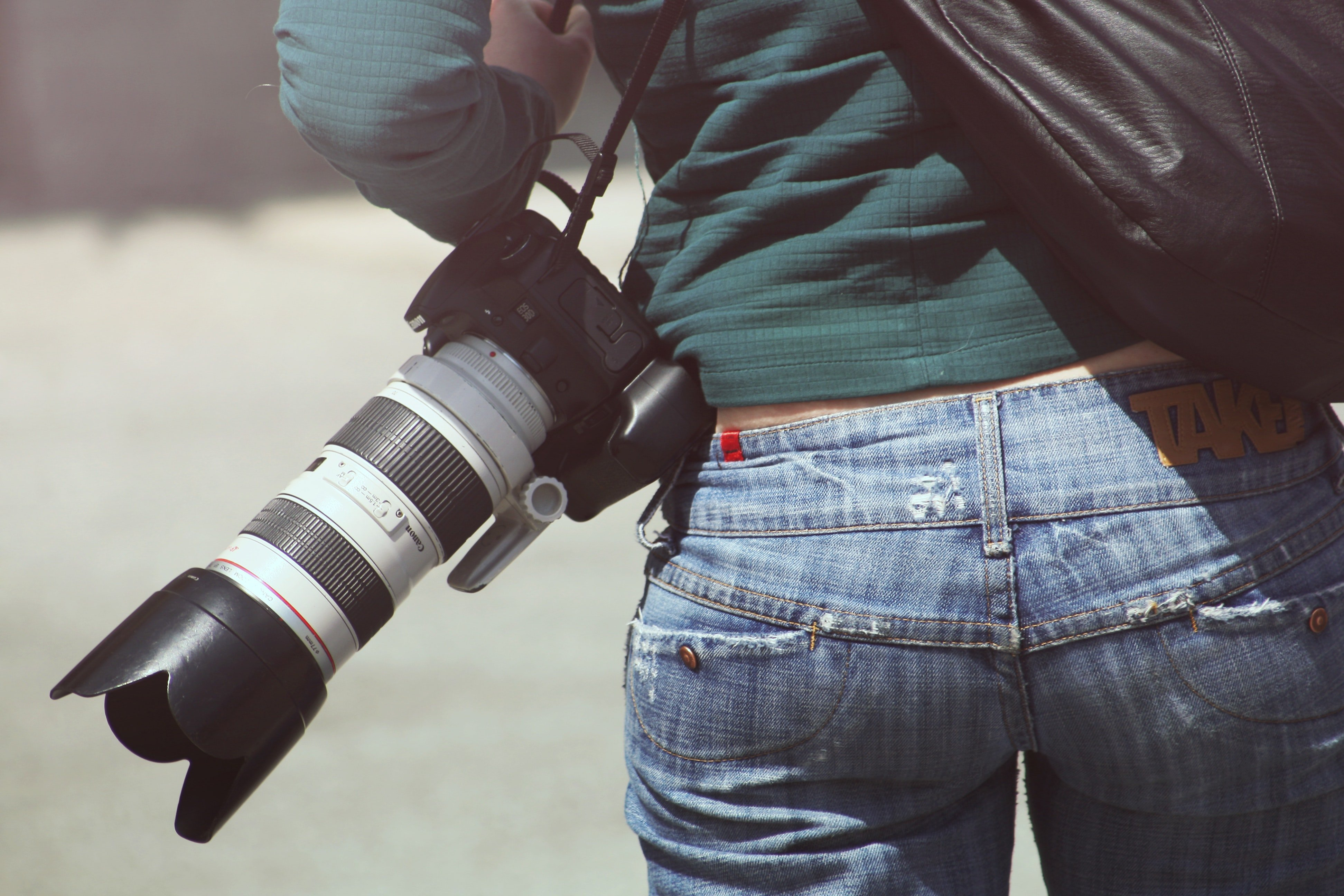 A journalist on field with their camera : Photo: Pexels