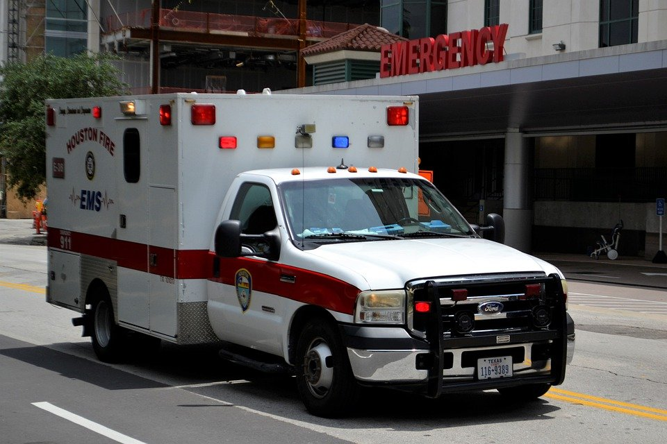 An ambulance in front of an emergency room.   Pixabay/ ArtisticOperations