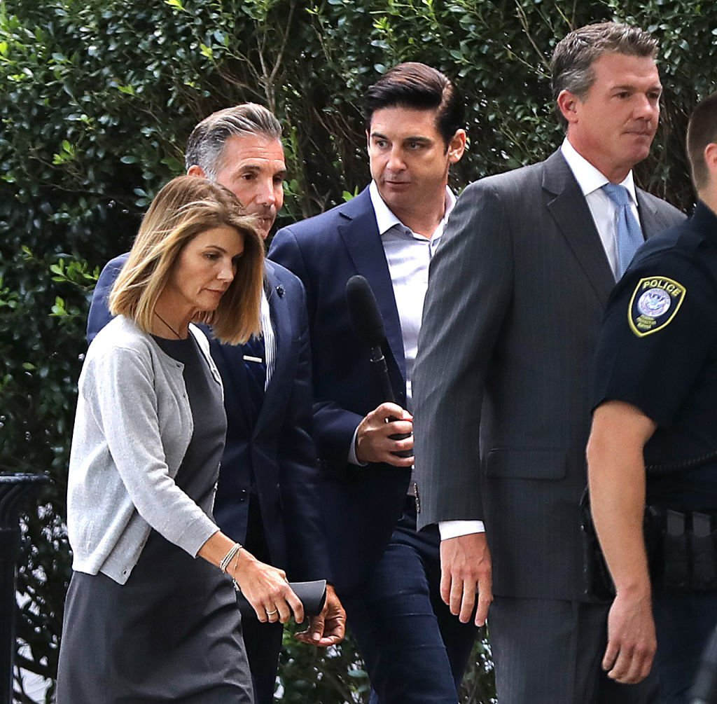 Lori Loughlin, far left, and her husband Mossimo Giannulli, second from left, leave the John Joseph Moakley United States Courthouse in Boston | Photo: Getty Images