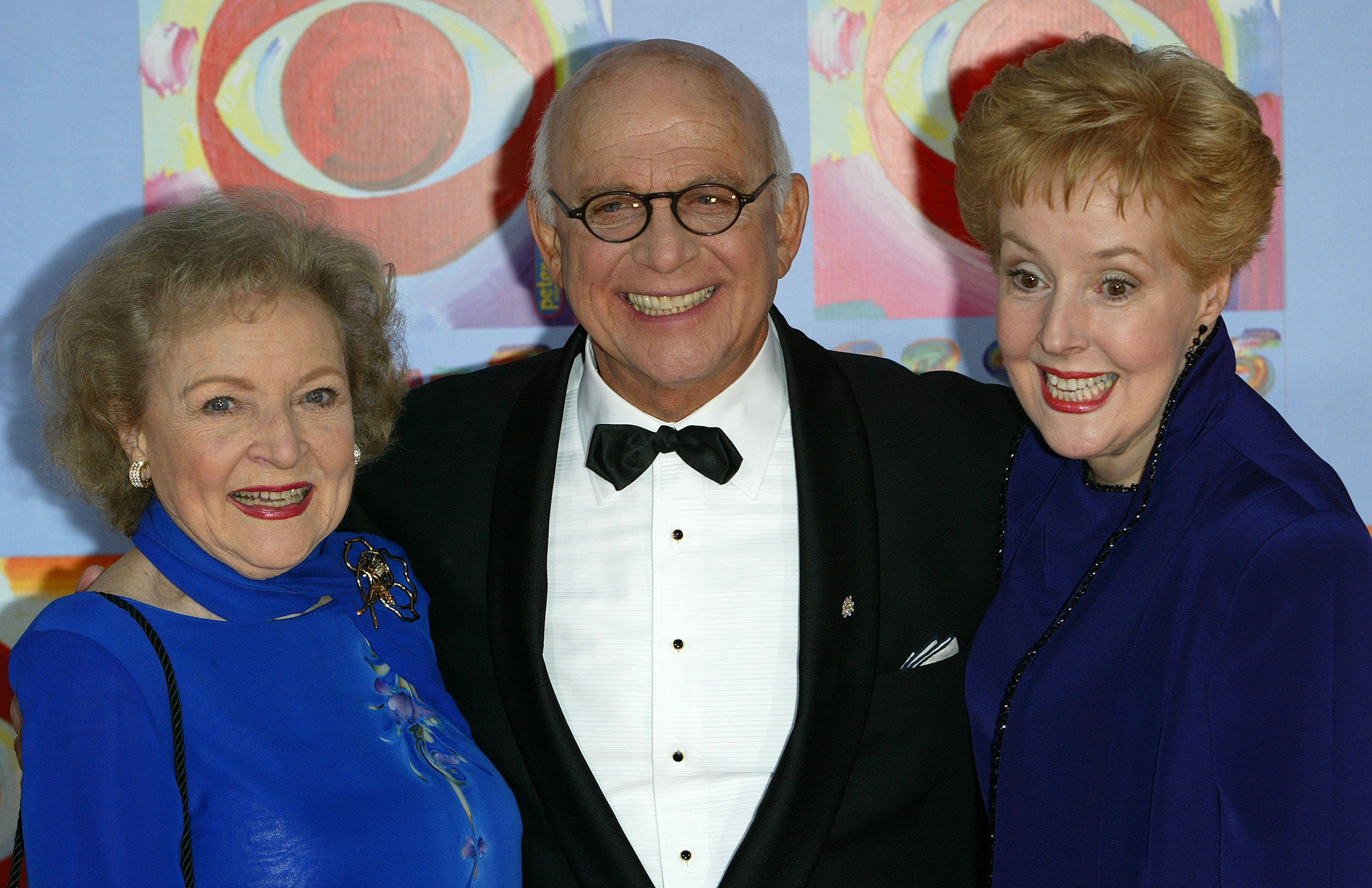 From left to right, Betty White, Gavin Macleod and actress Georgia Engel at the 'CBS At 75' celebration at the Hammerstein Ballroom in 2003. Photo: Getty Images