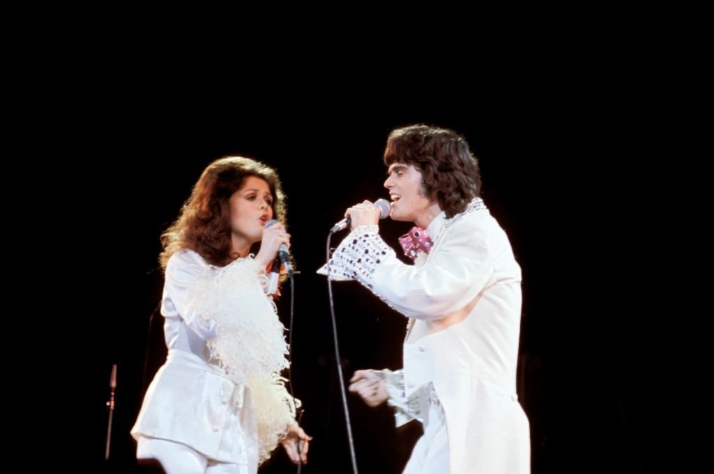 Marie and Donnie Osmond performing on stage | Source: Getty Images