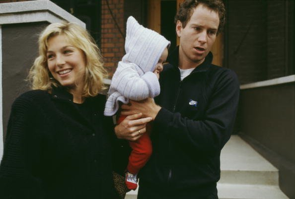 American tennis player John McEnroe with his wife, actress Tatum O'Neal, and one of their children, circa 1987. | Source: Getty Images.