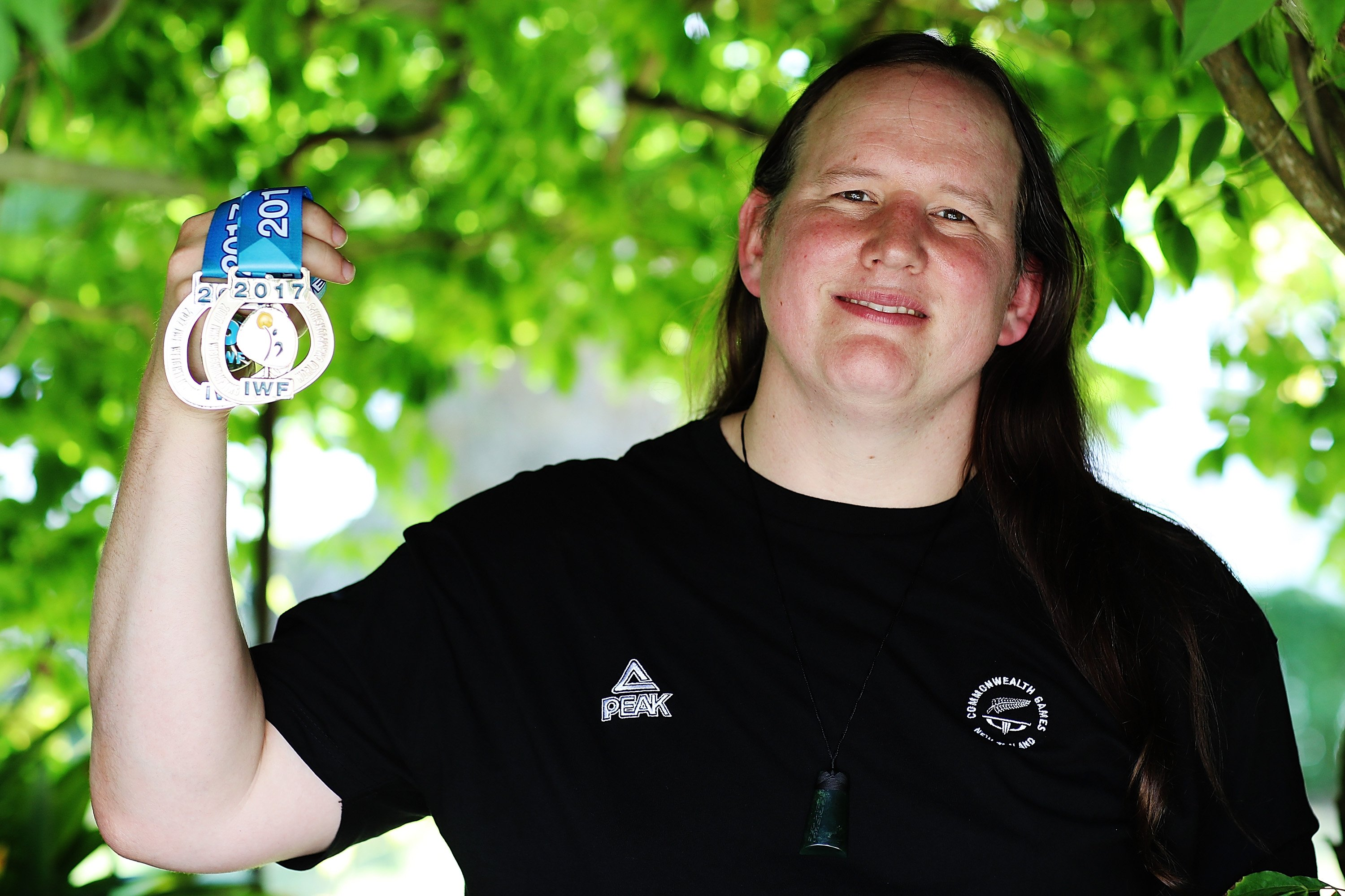 Transgender weightlifter Laurel Hubbard posing with two of her medals during a photoshoot in Auckland, New Zealand | Photo: Hannah Peters/Getty Images