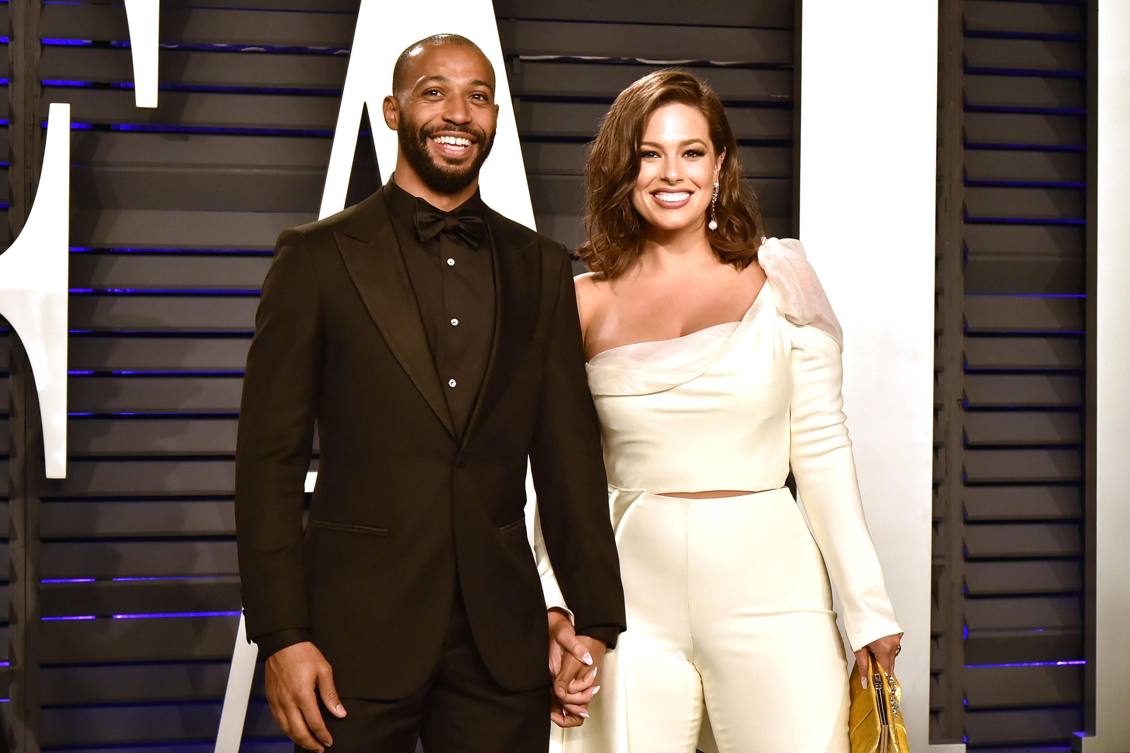 Justin Ervin and Ashley Graham attend the 2019 Vanity Fair Oscar Party on February 24, 2019.   Photo: Getty Images