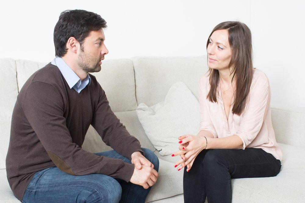 A photo of a man and a woman talking | Photo: Shutterstock