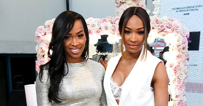 Check Out Malika Haqq as She Poses with Pregnant Twin Sister Khadijah in These Stunning Outfits