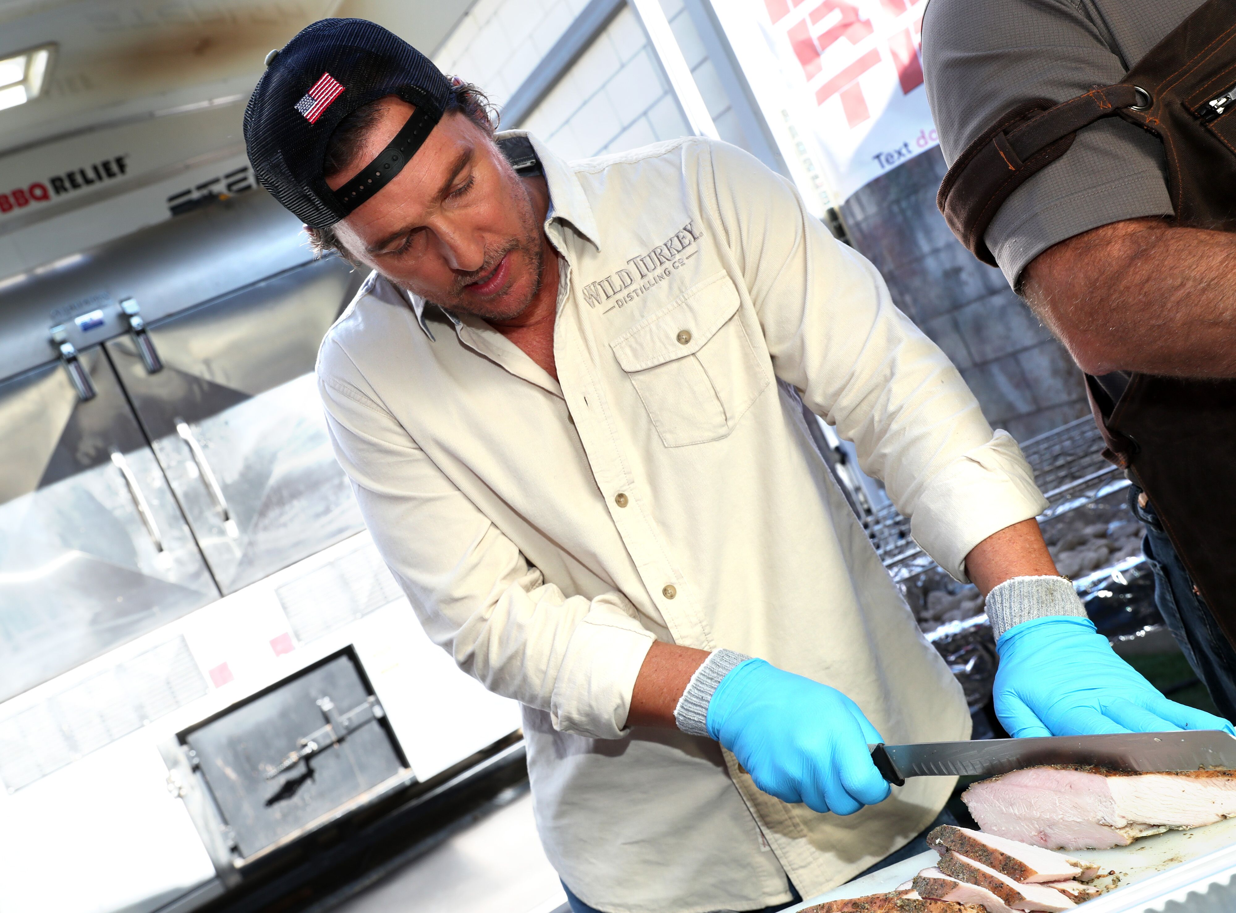 """Matthew McConaughey prepares food during Wild Turkey """"With Thanks"""" 2019 with Matthew McConaughey and Operation BBQ Relief on November 01, 2019 in Los Angeles, California.  