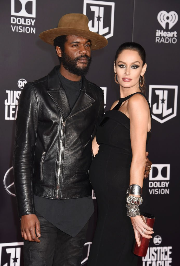 "Gary Clark Jr. and Nicole Trunfio arrive at the premiere of Warner Bros. Pictures' ""Justice League"" at the Dolby Theater on November 13, 2017. 