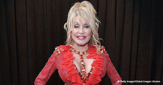 Dolly Parton turns heads in sparkling red dress, and all eyes are on her seductive cleavage