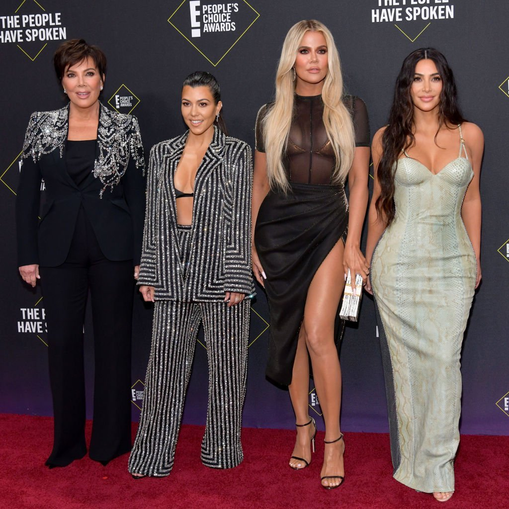 Kris Jenner with her daughters, Kourtney, Khloe, and Kim Kardashian attending the E! People's Choice Awards on November 10, 2019. | Photo: Getty Images