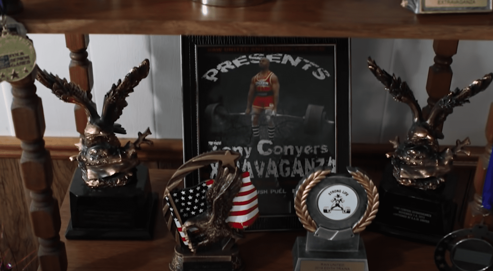 100-year-old woman's powerlifting trophies stand on her cabinet   Photo: Youtube/Guinness World Records