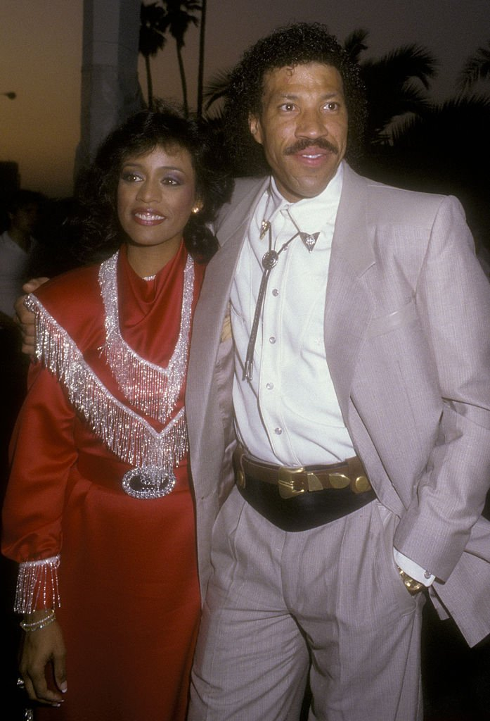 Lionel Richie and Brenda Harvey attend Share Boomtown Party on May 1, 1985 | Photo: Getty Images