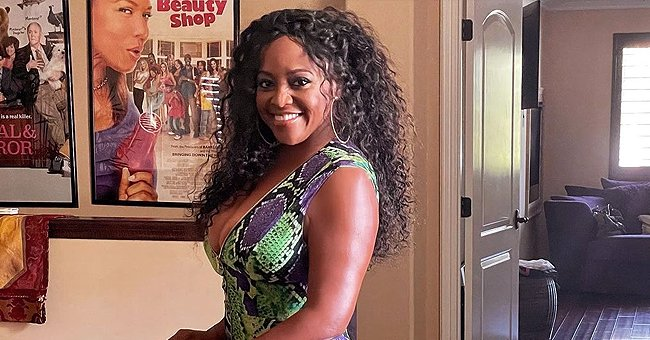 Sherri Shepherd Flaunts Her Weight Loss in a Snake-Print Pleated Dress While Posing in New Pics