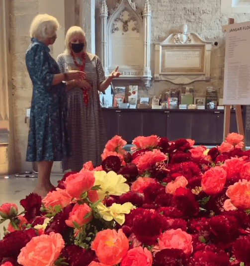 Camilla, Duchess of Cornwall viewing the display at the Garden Museum. | Photo: Instagram/clarencehouse