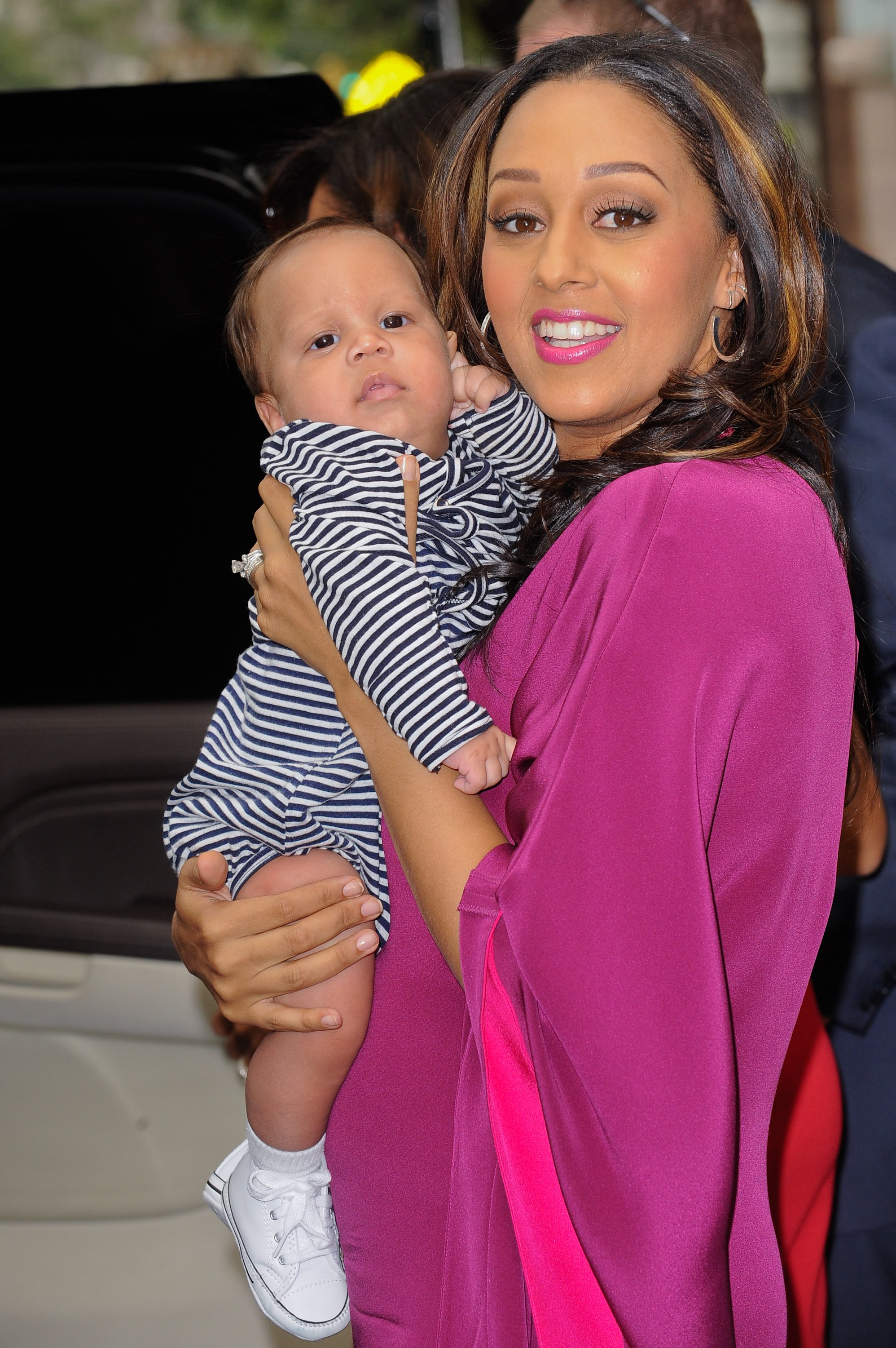 """Tia Mowry and son Cree Hardrict leave the """"Wendy Williams Show"""" set in New York City on September 27, 2011 