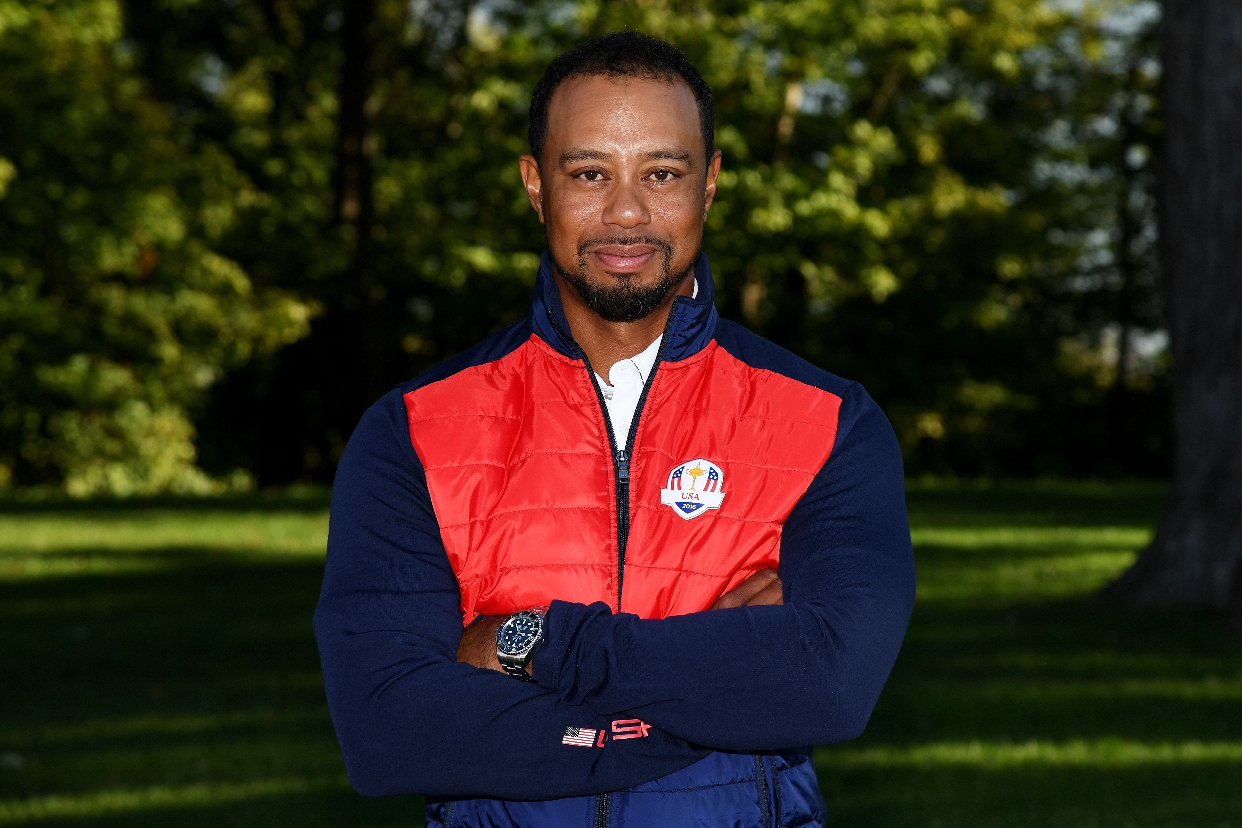 Tiger Woods poses during team photocalls prior to the 2016 Ryder Cup at Hazeltine National Golf Club on September 27, 2016 in Chaska, Minnesota. | Source: Getty Images